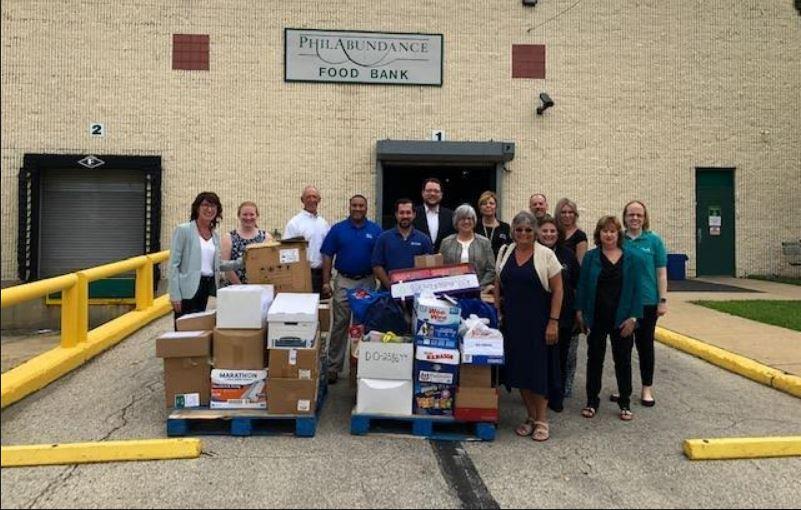 Credit unions and legislators donate 1,405 pounds of food to Philabundance
