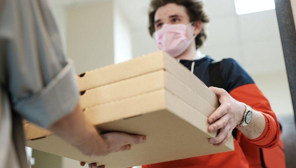 maske dman with pizza boxes