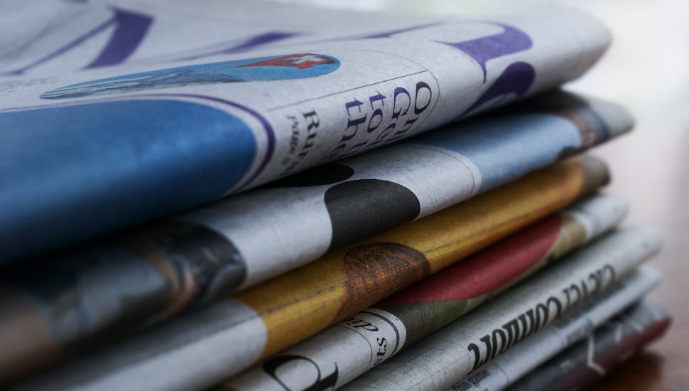 Stack of neatly folded Newspapers
