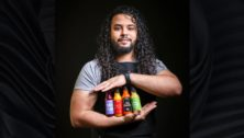 Radhi Fernandez with his Faiya Hot Sauces.