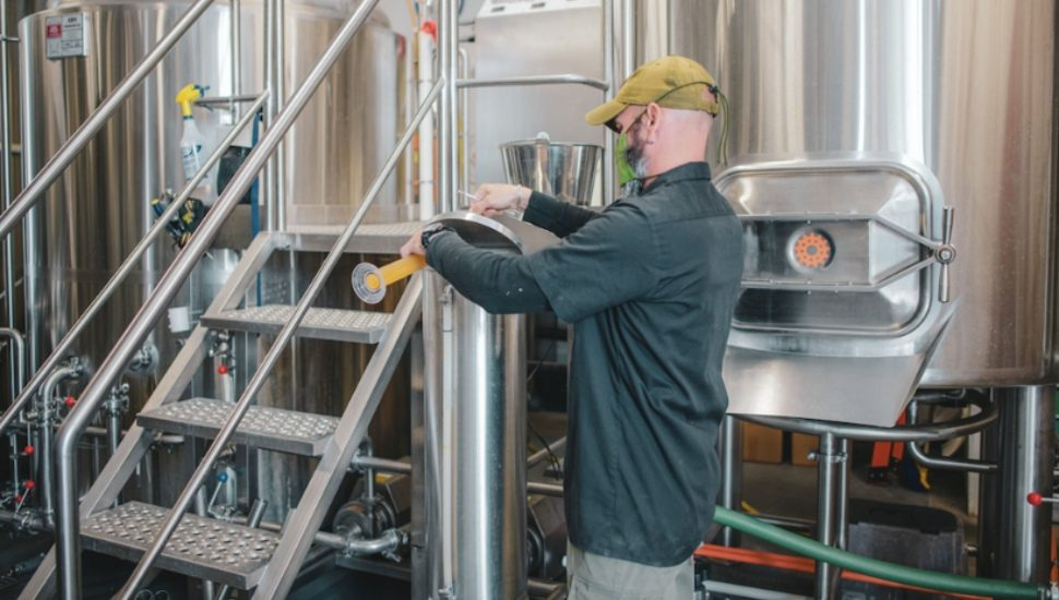 Man creating beer Adapt and Overcome