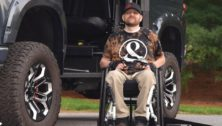 man in wheelchair getting non-profit assistance