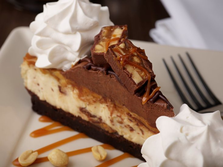 Dine at the King of Prussia Mall and enjoy Cheesecake factory Snickers cheesecake.