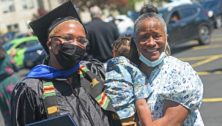 Manor College graduate with family