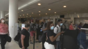 A crowd waits inStaffing Shortages at Philadelphia International Airport