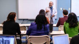 A professor teaches a class at Neumann University. A leadership certificate is now offered.