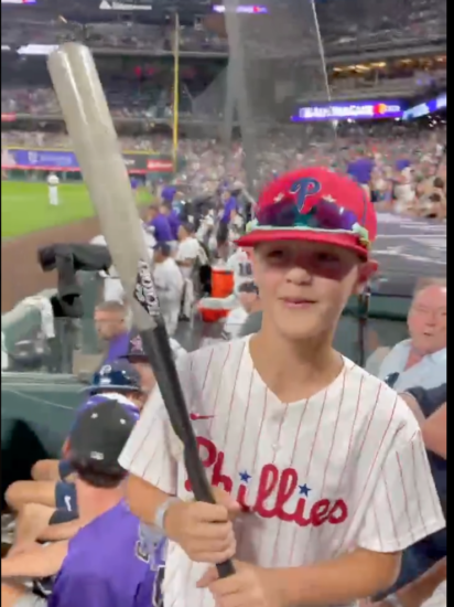 boy gets signed bat from Phillie.