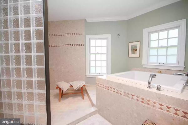 bathroom with soaking tub montco