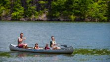 Canoeing in July on lake