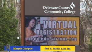 The Delaware County Community College billboard outside its Marple campus. College vaccinations are being implemented at local universities.