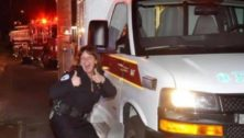 Mary Ellis strikes a humorous pose while working as an EMT.