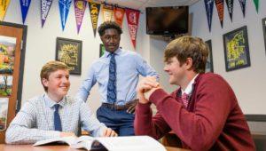 three students at La Salle College High School