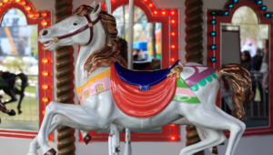 Colorful house on a carousel.