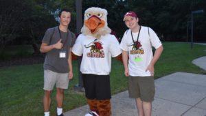 College students with Gwynedd Mercy University mascot