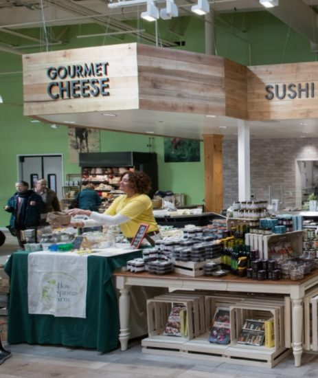 Woman offering cheese samples in Kimberton Whole Foods.
