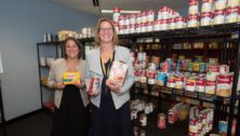 Rina Keller and Mary Beth Davis stand in the Knights' Pantry, a new food pantry for students at Neumann University