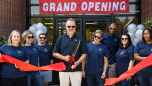 Members of The Lincoln Center cut the ribbon at the entrance to their new building.