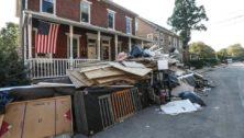 Debris piled in street after Hurricane Ida