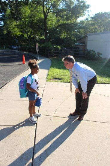 Rich Nourie greeting a student.