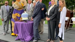 WCU Mascot Rammy Prepares to cut the official Anniversary Cupcake with President Fiorentino.