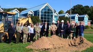 A group of people participating in a ground breaking ceremony for a new athletic facility at Valley Forge Military Academy.