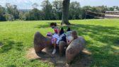 kids sitting on a rock reading