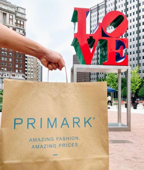 Primark shopping bag in front of Love Park in Philadelphia.