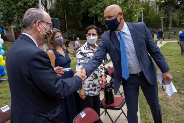 Superintendent William R. Hite Jr. greets Mayor Jim Kenney at a celebration of Penn Alexander's National Blue Ribbon.