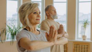 Retired adults doing yoga