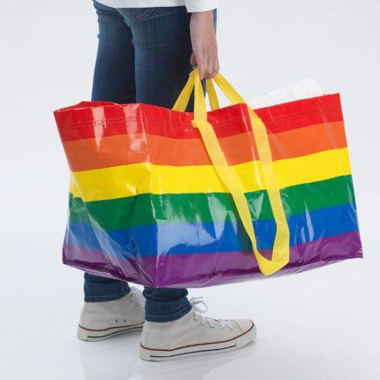 IKEA Rainbow bag carried by a man.