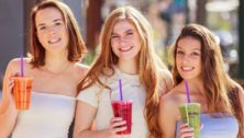 Three girls with drinks in the Philadelphia suburbs.