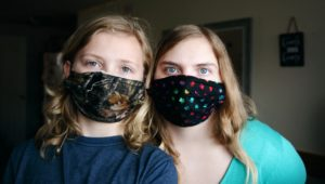 child and mom with masks