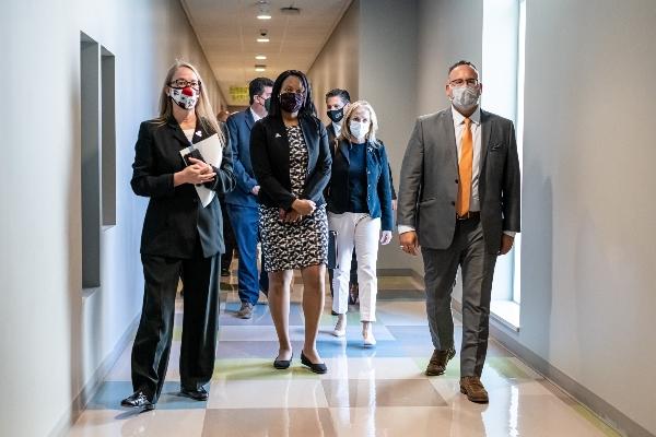 People walking in hallway.