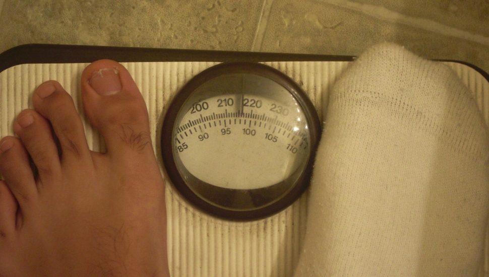 obesity feet on scale