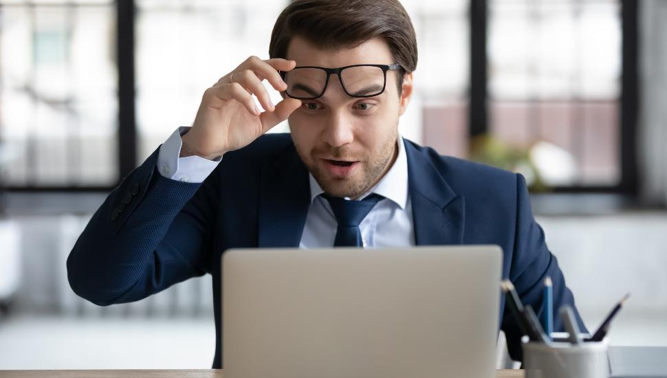 Man staring at his laptop