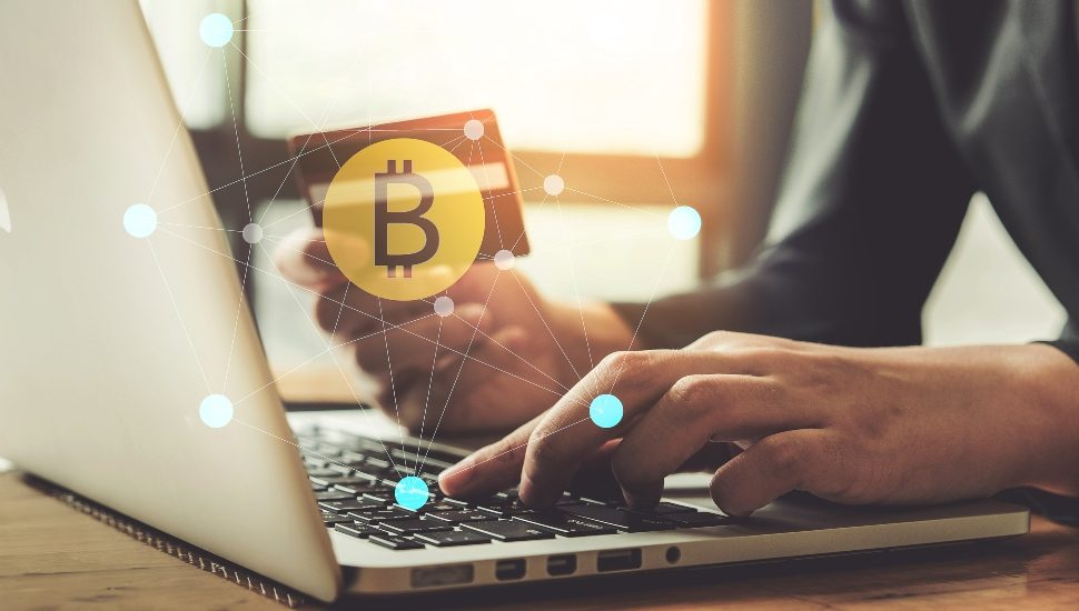 Man buying Bitcoin with a Laptop