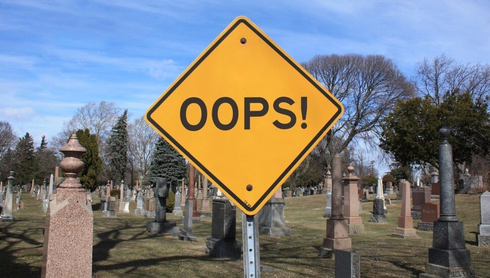 Oops! Sign in a graveyard
