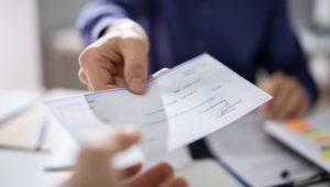 A man receiving his paycheck