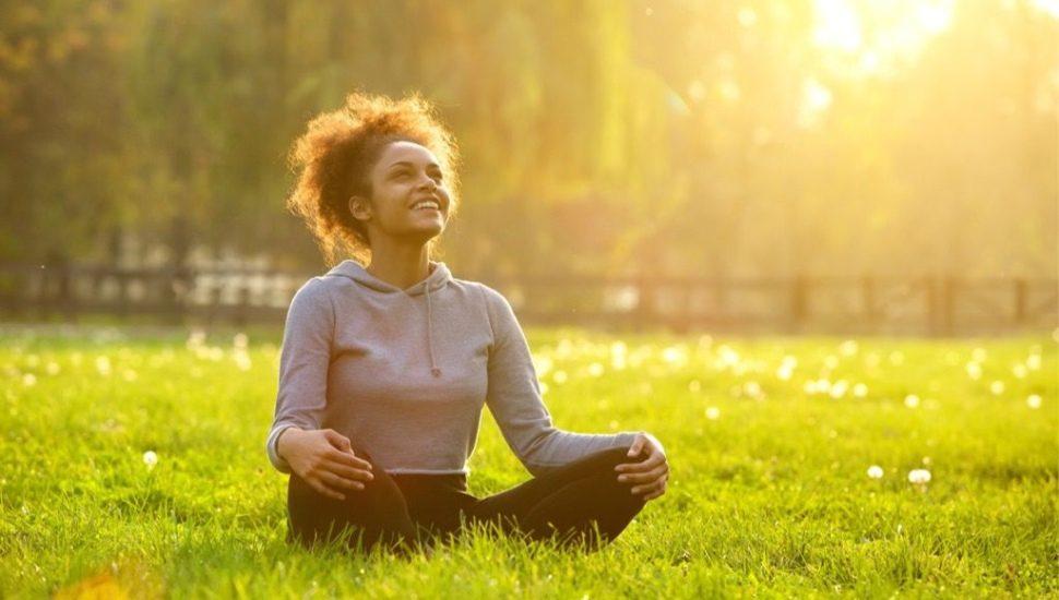 wellness week girl in grass
