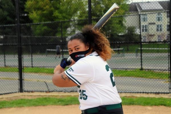 High school girl playing softball.